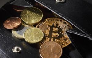 BERLIN, GERMANY - DECEMBER 06: A close-up view of an illustration model of a Bitcoin is seen in a wallet with different Euro Coins on December 6, 2013 in Berlin, Germany. Central bankers around the world have warned about the virtual currency bitcoin. Prices have soared as more merchants accept it as payment and investors are pouring money into new bitcoin-related ventures.  (Photo Illustration by Thomas Trutschel/Photothek via Getty Images)